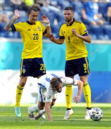 Patrik Hrosovsky (front) of Slovakia in action against Swedish players Kristoffer Olsson (L) and Marcus Berg (R) during the UEFA EURO 2020 group E preliminary round soccer match between Sweden and Slovakia in St.Petersburg, Russia, 18 June 2021.