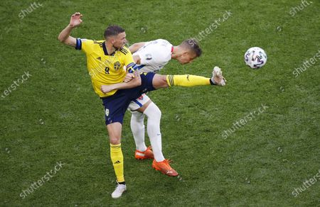 Marcus Berg (L) of Sweden in action against L'ubomir Satka of Slovakia during the UEFA EURO 2020 group E preliminary round soccer match between Sweden and Slovakia in St. Petersburg, Russia, 18 June 2021.