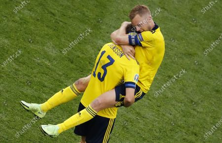 Stock Photo of Sebastian Larsson (top) of Sweden and Gustav Svensson of Sweden celebrate after winning the UEFA EURO 2020 group E preliminary round soccer match between Sweden and Slovakia in St.Petersburg, Russia, 18 June 2021.