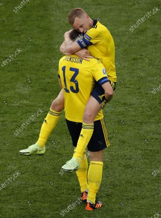 Stock Picture of Sebastian Larsson (top) of Sweden and Gustav Svensson of Sweden celebrate after winning the UEFA EURO 2020 group E preliminary round soccer match between Sweden and Slovakia in St.Petersburg, Russia, 18 June 2021.