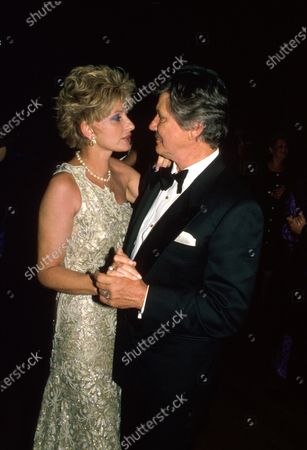 Married actors Jill Ireland and Charles Bronson dancing.