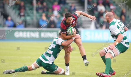 Sean Maitland of Saracens tackled by Rayn Smid of Ealing Trailfinders