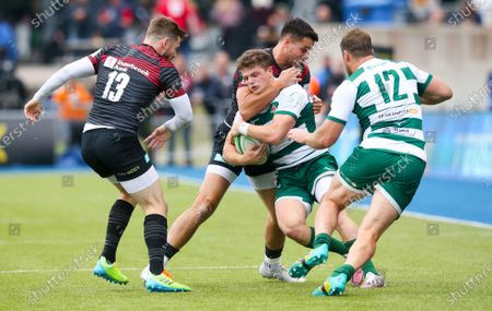 Angus Kernohan of Ealing Trailfinders is high tackled by Sean Maitland of Saracens - Elliot Daly of Saracens (L) & Pat Howard of Ealing Trailfinders (R)