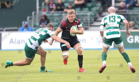 Jackson Wray of Saracens is tackled by Pat Howard of Ealing Trailfinders (L)