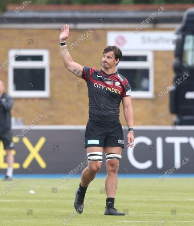 Michael Rhodes of Saracens waves goodbye to the supporters after being sent off