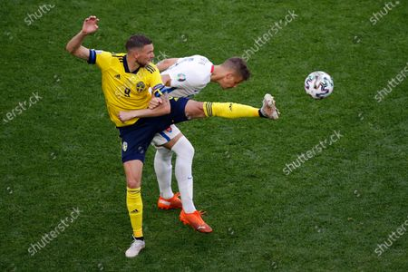 Sweden's Marcus Berg, foreground, and Slovakia's Lubomir Satka challenge for the ball during the Euro 2020 soccer championship group E match between Sweden and Slovakia at the Saint Petersburg stadium, in St. Petersburg, Russia