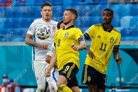 Sweden's Marcus Berg eyes the ball during the Euro 2020 soccer championship group E match between Sweden and Slovakia, at the Saint Petersburg stadium, in Saint Petersburg, Russia