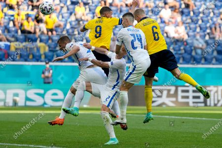 Sweden's Ludwig Augustinsson, right and Sweden's Marcus Berg, number 9,jump along with Slovakia's Martin Koscelnik, left, and Peter Pekarik, center, during the Euro 2020 soccer championship group E match between Sweden and Slovakia, at the Saint Petersburg stadium, in Saint Petersburg, Russia