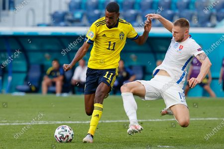 Slovakia's Milan Skriniar, right, challenges Sweden's Alexander Isak during the Euro 2020 soccer championship group E match between Sweden and Slovakia, at the Saint Petersburg stadium, in Saint Petersburg, Russia