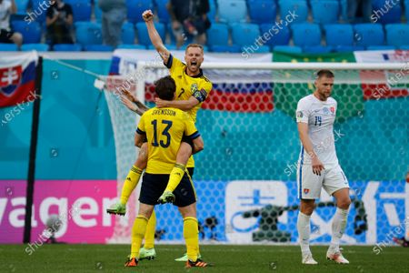 Sweden's Sebastian Larsson, top, celebrates with Sweden's Gustav Svensson after the Euro 2020 soccer championship group E match between Sweden and Slovakia, at the Saint Petersburg stadium, in Saint Petersburg, Russia, . Sweden won 1-0