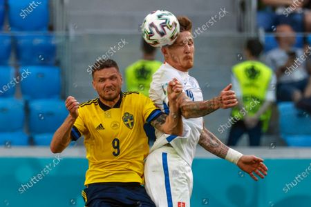 Sweden's Marcus Berg, left, and Slovakia's Juraj Kucka vie for the ball during the Euro 2020 soccer championship group E match between Sweden and Slovakia, at the Saint Petersburg stadium, in Saint Petersburg, Russia