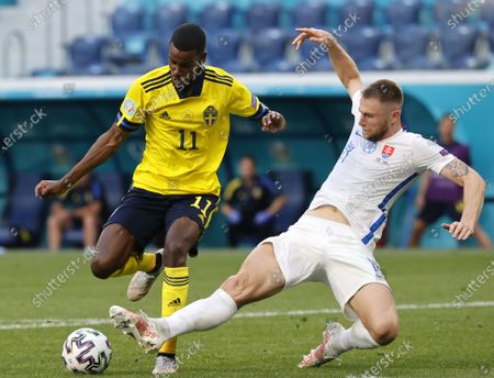 Alexander Isak (L) of Sweden in action against Milan Skriniar of Slovakia during the UEFA EURO 2020 group E preliminary round soccer match between Sweden and Slovakia in St.Petersburg, Russia, 18 June 2021.