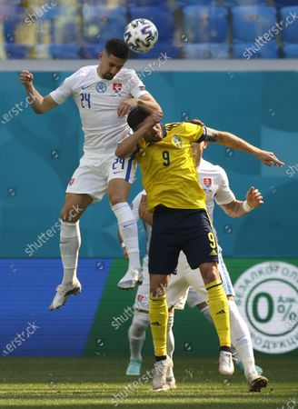 Marcus Berg (R) of Sweden in action against Martin Koscelnik of Slovakia during the UEFA EURO 2020 group E preliminary round soccer match between Sweden and Slovakia in St.Petersburg, Russia, 18 June 2021.