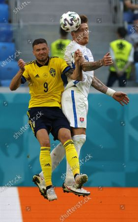 Marcus Berg (L) of Sweden in action against Juraj Kucka of Slovakia during the UEFA EURO 2020 group E preliminary round soccer match between Sweden and Slovakia in St.Petersburg, Russia, 18 June 2021.