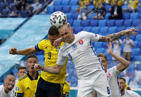 Marcus Berg (CL) of Sweden in action against Ondrej Duda (CR) of Slovakia during the UEFA EURO 2020 group E preliminary round soccer match between Sweden and Slovakia in St.Petersburg, Russia, 18 June 2021.
