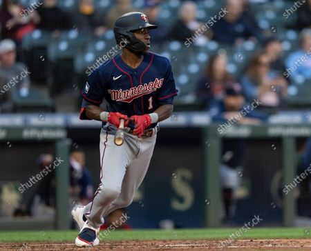 Minnesota Twins' Nick Gordon runs to first base after putting the ball in play during an at-bat in a baseball game against the Seattle Mariners, in Seattle. The Mariners won 10-0