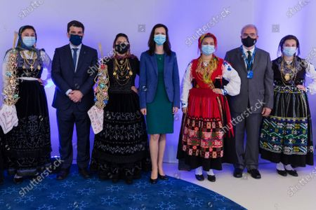 Stock Image of Portuguese Minister for Education Tiago Brandao Rodrigues (2-L) flanked by European Union Commissioner for Innovation Research Culture Education and Youth Mariya Gabriel (C) and Jose Maria Costa, Mayor of Viana do Castelo (2-R) pose with women dressed in Viana traditional clothes called 'Vianesas' prior the European Solidarity Corps Launch in Viana do Castelo Cultural Centre, Portugal, 18 June 2021.