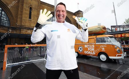 Stock Picture of Former England Goalkeeper David Seaman made an appearance Kings Cross St.Pancras to give football fans free sausage rolls for goals scored, as part of a partnership between Just Eat and Greggs to celebrate Just Eat's sponsorship of UEFA EURO 2020.
