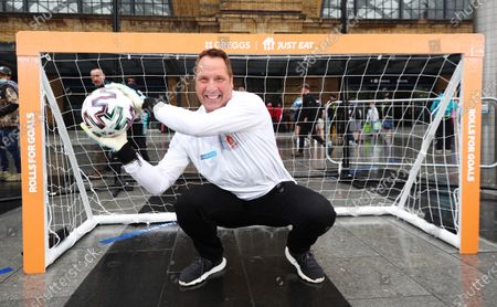 Stock Image of Former England Goalkeeper David Seaman made an appearance Kings Cross St.Pancras to give football fans free sausage rolls for goals scored, as part of a partnership between Just Eat and Greggs to celebrate Just Eat's sponsorship of UEFA EURO 2020.