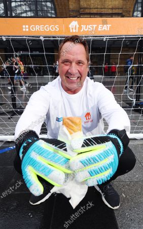 Stock Photo of Former England Goalkeeper David Seaman made an appearance Kings Cross St.Pancras to give football fans free sausage rolls for goals scored, as part of a partnership between Just Eat and Greggs to celebrate Just Eat's sponsorship of UEFA EURO 2020.