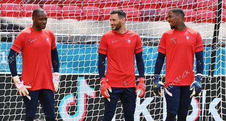 France's goalies Steve Mandanda, Hugo Lloris and Mike Maignan (L-R) attend a training session at the Ferenc Puskas stadium in Budapest, Hungary, 18 June 2021, the day before the Euro 2020 soccer championship group F match between Hungary and France.