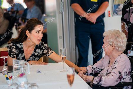 Danish Crown Princess Mary (L) visits the Naeldebjerg retirement home in Greve, Denmark, 18 June 2021.