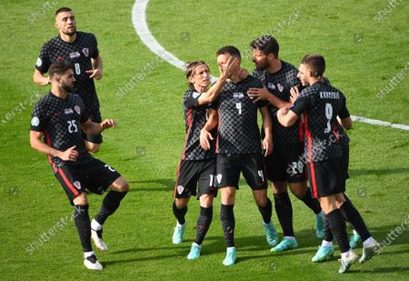 Ivan Perisic (3-R) of Croatia celebrates with teammates after scoring the 1-1 equalizer during the UEFA EURO 2020 group D preliminary round soccer match between Croatia and the Czech Republic in Glasgow, Britain, 18 June 2021.