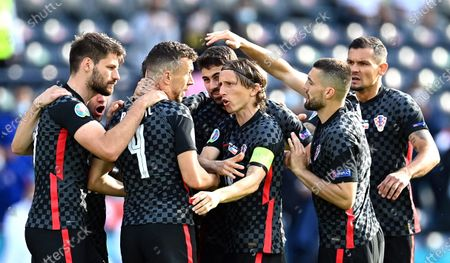 Ivan Perisic (C-L) of Croatia celebrates with teammates after scoring the 1-1 equalizer during the UEFA EURO 2020 group D preliminary round soccer match between Croatia and the Czech Republic in Glasgow, Britain, 18 June 2021.