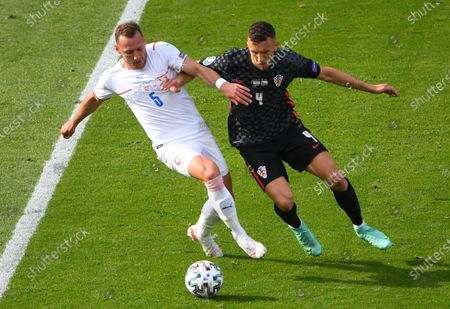 Vladimir Coufal (L) of the Czech Republic in action against Ivan Perisic of Croatia during the UEFA EURO 2020 group D preliminary round soccer match between Croatia and the Czech Republic in Glasgow, Britain, 18 June 2021.