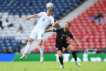 Czech Republic's Jan Boril, left, challenges for the ball with Croatia's Ivan Perisic during the Euro 2020 soccer championship group D match between Croatia and the Czech Republic at the Hampden Park stadium in Glasgow