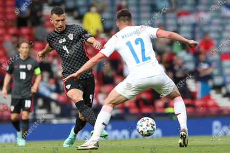 Croatia's Ivan Perisic challenges for the ball with Czech Republic's Lukas Masopust during the Euro 2020 soccer championship group D match between Croatia and the Czech Republic at the Hampden Park stadium in Glasgow