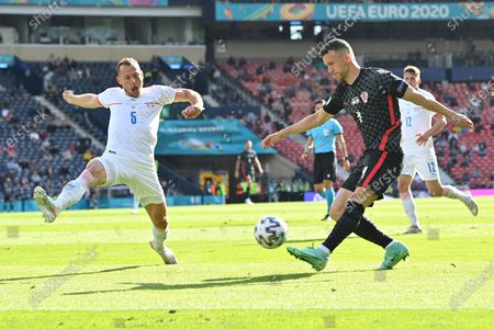 Croatia's Ivan Perisic, kicks the ball next to Czech Republic's Vladimir Coufal during the Euro 2020 soccer championship group D match between Croatia and the Czech Republic at the Hampden Park stadium in Glasgow