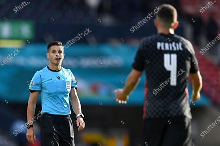 Croatia's Ivan Perisic gestures to the referee after the final whistle of the Euro 2020 soccer championship group D match between Croatia and the Czech Republic at the Hampden Park stadium in Glasgow