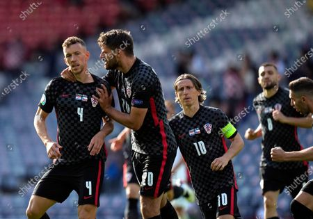 Croatia's Ivan Perisic, left, celebrates with teammates after scoring his side's opening goal during the Euro 2020 soccer championship group D match between Croatia and Czech Republic at the Hampden Park Stadium in Glasgow
