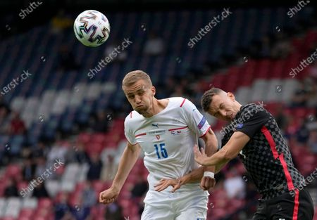 Czech Republic's Tomas Soucek, left, and Croatia's Ivan Perisic jumps for the ball during the Euro 2020 soccer championship group D match between Croatia and Czech Republic at the Hampden Park Stadium in Glasgow