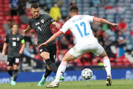 Stock Image of Ivan Perisic (L) of Croatia in action against Lukas Masopust of the Czech Republic during the UEFA EURO 2020 group D preliminary round soccer match between Croatia and the Czech Republic in Glasgow, Britain, 18 June 2021.