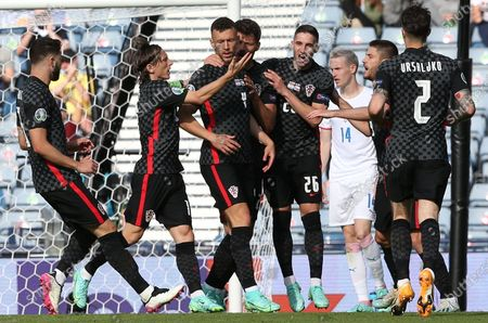 Ivan Perisic (C) of Croatia celebrates with team-mats after scoring the 1-1 goal during the UEFA EURO 2020 group D preliminary round soccer match between Croatia and the Czech Republic in Glasgow, Britain, 18 June 2021.