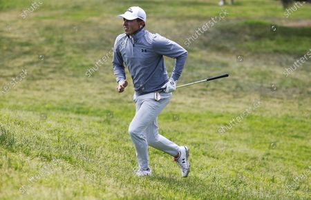 Matt Fitzpatrick of England jogs up the green after chipping on the thirteenth hole during the second round of the 2021 US Open golf tournament on the South Course of the Torrey Pines Golf Course in San Diego, California, USA, 18 June 2021.