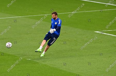 Goalkeeper David Marshall of Scotland warms up prior to the UEFA EURO 2020 group D preliminary round soccer match between England and Scotland in London, Britain, 18 June 2021.