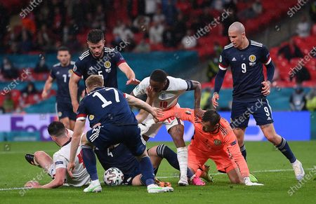 Stock Picture of Raheem Sterling (C) of England in action against Goalkeeper David Marshall (2-R) of Scotland during the UEFA EURO 2020 group D preliminary round soccer match between England and Scotland in London, Britain, 18 June 2021.
