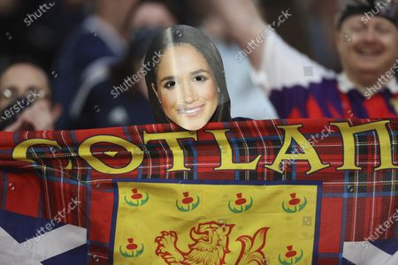 Scotland fan in a Meghan Markle mask shows a flag before the Euro 2020 soccer championship group D match between England and Scotland at Wembley stadium in London