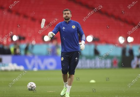Scotland's goalkeeper David Marshall warms up before the Euro 2020 soccer championship group D match between England and Scotland at Wembley stadium in London
