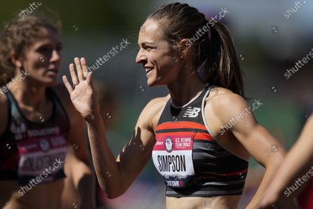 Jenny Simpson, right, celebrates after winning the first heat in the women's 1500-meter run at the U.S. Olympic Track and Field Trials, in Eugene, Ore