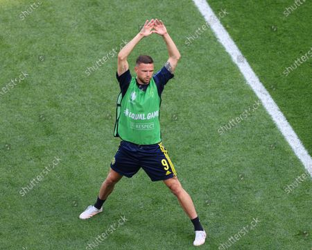 Marcus Berg (9) of Sweden stretching  during the European championship EURO 2020 between Sweden and Slovakia at Gazprom Arena. (Final Score; Sweden 1:0 Slovakia).