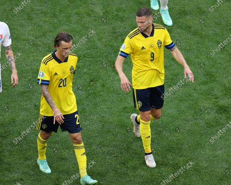 Stock Photo of Marcus Berg (9) and Kristoffer Olsson (20) of Sweden in action during the European championship EURO 2020 between Sweden and Slovakia at Gazprom Arena.(Final Score; Sweden 1:0 Slovakia).