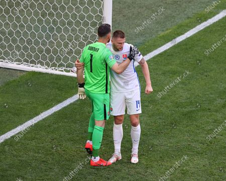 Martin Dubravka (1) and Milan Skriniar (14) of Slovakia in action during the European championship EURO 2020 between Sweden and Slovakia at Gazprom Arena.(Final Score; Sweden 1:0 Slovakia).