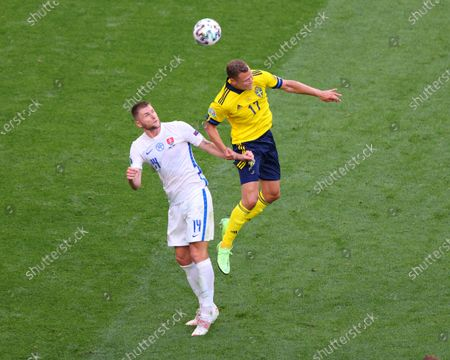 Viktor Claesson (17) of Sweden and Milan Skriniar (14) of Slovakia in action during the European championship EURO 2020 between Sweden and Slovakia at Gazprom Arena.(Final Score; Sweden 1:0 Slovakia).