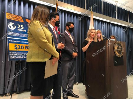 Stock Picture of Actress Alyssa Milano at podium and Mira Sorvino, second right, joins activists to discuss new efforts to stop human trafficking in California, in Los Angeles