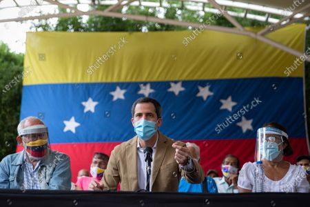 Venezuelan opposition leader Juan Guaido (C) speaks at a press conference in Caracas, Venezuela, 18 June 2021. Venezuelan opposition leader Juan Guaido assured that the international tour that an anti-Chavista delegation will undertake will aim to discuss the progressive lifting of sanctions if a possible negotiation agreement with the Government of Nicolas Maduro is fulfilled.