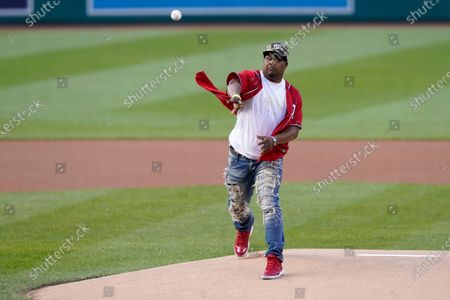 Capitol Police officer Eugene Goodman throws out the first pitch before the Washington Nationals baseball game against the New York Mets, in Washington